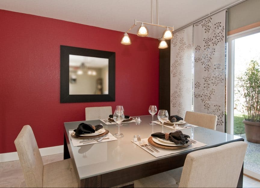 Red Dining Room with Warm Lighting