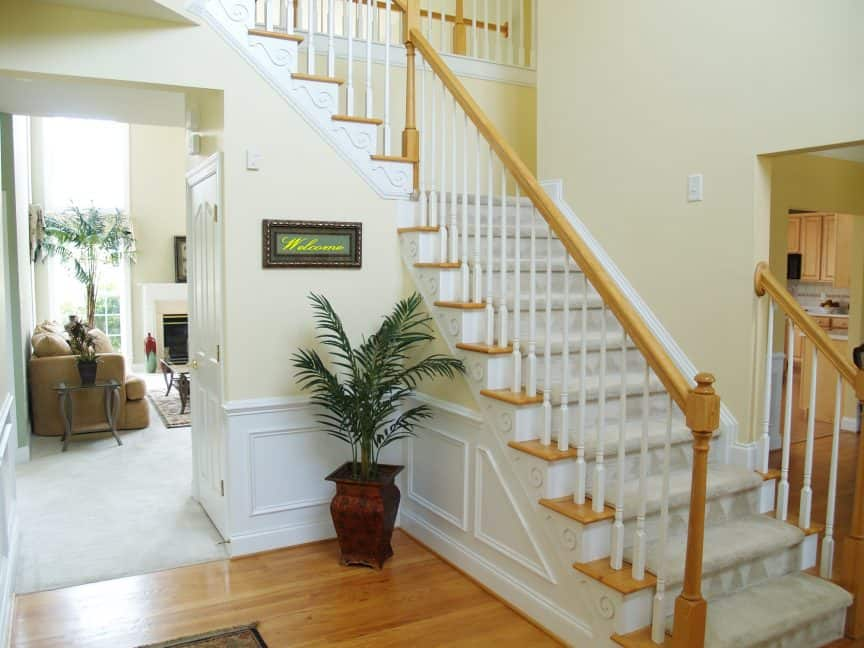 Stairs With Carpet Over Wood Flooring